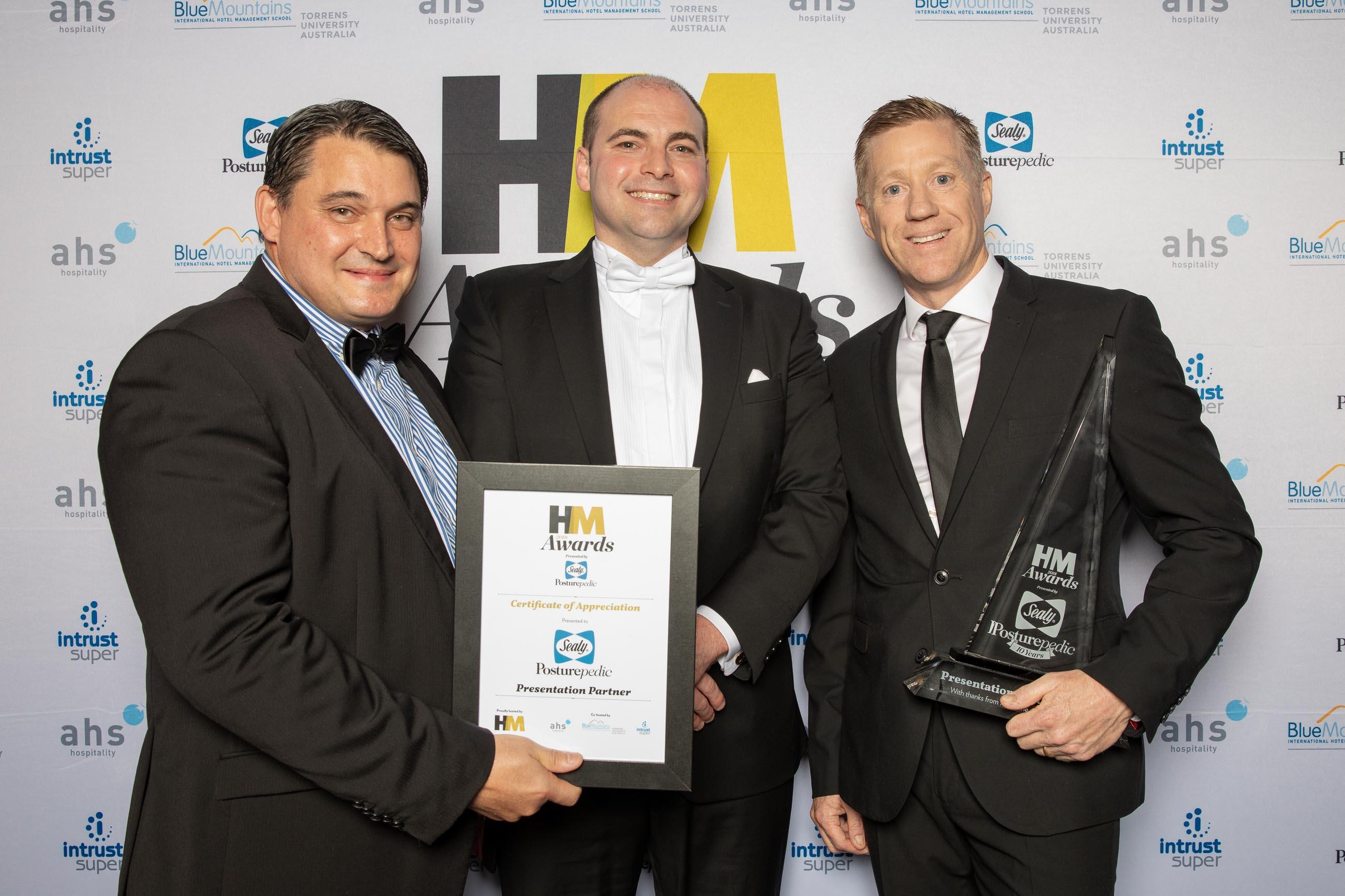 HM's Adam Daff presents Sealy with the sponsirshipo award